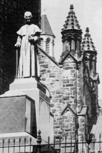 """A statue of the """"Apostle of the Alleghenies"""" was erected over his tomb in front of the St. Michael's Basilica in 1899, the centenary of Prince Gallitzin's arrival to the settlement and the founding of Loretto."""
