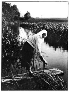 A Lithuanian peasant woman washing linen in a brook. (Turn of the century photograph.)