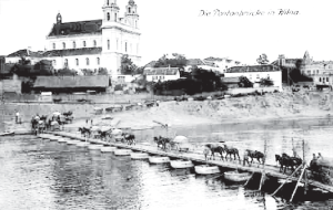 German military colum crosses a pontoon bridge over the Neris River in Vinius
