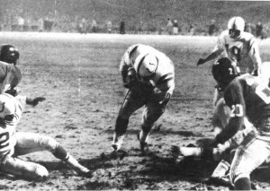 One of the most famous sports photographs ever depicts Johnny Unitas at the instant football's greatest game of all time ended. Unitas was named the game's most valuable player.