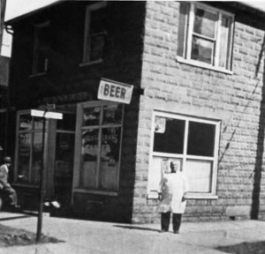 In this 1930s photograph, John Sabaitis stands in front of the restaurant-tavern he built himself with cement blocks he cast and hauled to the building site on a two wheel pushcart. The building stands to this day.