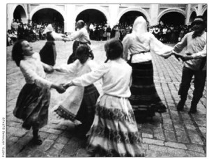 Young and old join in a lively dance in a courtyard of Vilnius University.