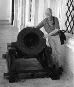The author with an ancient cannon guarding the castle's entrance.