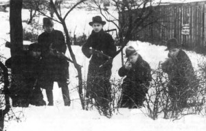 Armed volunteers gather on the outskirts of Klaipėda prior to their assault.