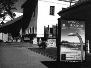 A poster in front of the museum invites passersby to visit the new Archaeology Exposition.
