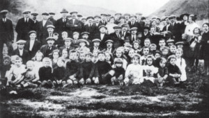 Lithuanian miners of Lanarkshire, Scotland and their families enjoy a picnic among the coal bings (culms) during the early part of the last century
