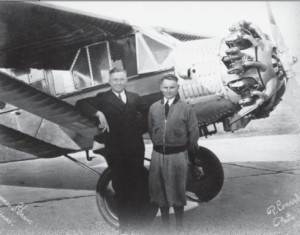 """Darius and Girėnas pose for Chicago photographers in front of the """"Lituanica."""" The picture was taken at the old Chicago Municipal Airport (now Midway Airport.)"""