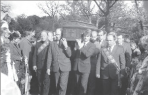The casket with the remains of Rimantas Stankevičius is being carried to its final resting place at the Aukštųjų Šančių Military Cemetery in Kaunas. The pallbearer on the right of the casket is current Lithuanian President Rolandas Paksas, a flyer himself.