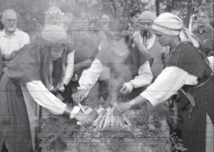 Lighting a ritual fire during a Rasos celebration.