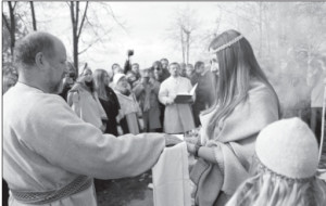 Jonas Trinkūnas (left), is initiated as the spiritual leader (Krivis) of Romuva in Lithuania.