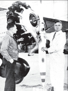 """Girėnas (left) and Darius mount a new propeller on the """"Lituanica."""""""