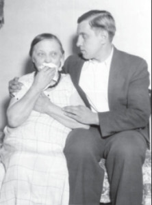 Stanley Girėnas' mother is being comforted by his brother.