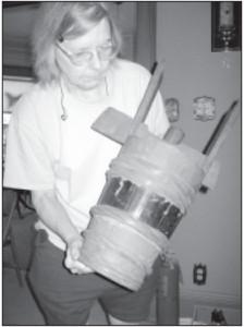 Mel's wife Janet checks an old butter churn.