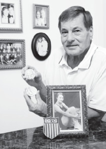 David Van Aken proudly displays his mother's Olympic gold medals and other memorabilia.