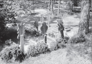 Grave markers called krikštai in the church's graveyard.
