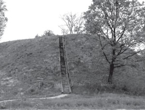 The Geruliai hillfort with wooden stairs leading to its top.