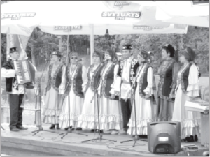 A Tatar singing group performs at a festival in a Vilnius park.