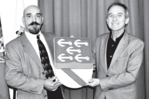 Manuel Rosa (left) presents Columbus's coat of arms that he located in 2001 to Carlos Calado, President of the Association Cristóbal Colón of Portugal