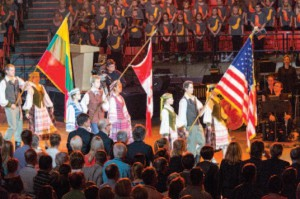 All rise as the flags of the United States of America, Canada and Lithuania enter the UIC Pavilion. (Photo by A. Zabulionis)