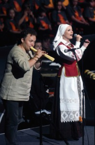 "Two soloists from Lithuania brought their artistry to the song festival. Shown here, singer Rasa Serra and musician Saulius Petreikis perform a Lithuanian folk song ""Vaikštinėjo Tėvulis"" (""My Dear Dad Was Walking"")(Photo by J. Kuprys)"
