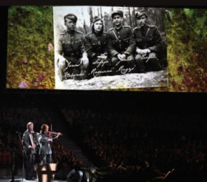"The Festival honored partisans who gave their lives fighting for Lithuania's freedom. The chorus sang the song ""Partizano Mirtis"" (""Death of the Partisan""). The music was by Faustas Strolia, a beloved choirmaster who passed away last December. Violinist Rūta Pakštaitė- Cole, accordionist Rimas Polikaitis and recorder player Saulius Petreikis accompanied the song. (Photo by J. Kuprys)"