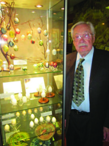 Stanley in his museum with an Easter egg exhibit.