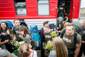 Mission Siberia participants are greeted with flowers upon their return to Vilnius.