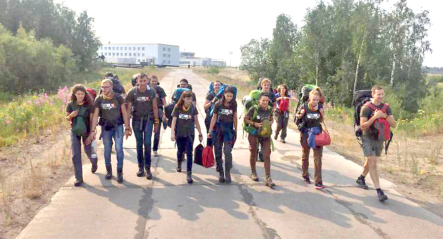 Mission Siberia participants making their way to a Lithuanian cemetery.