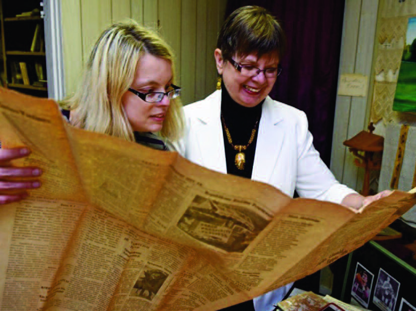 The author and her mother, Elaine, reading an archival copy of the Saulė newspaper.