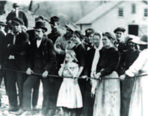Miner families anxiously await news of the fate of their loved ones after the Courtney mine explosion. Twenty percent of the deceased were Lithuanian Americans. The story was published in the May 15, 1913 issue of Draugas. (Photo credit: U.S. Dept. Labor and Mine Safety and Health Administration – MSHA; via M. Startare, TribLive.com)