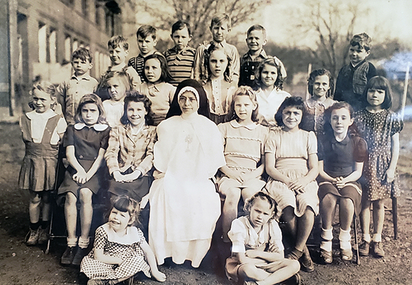 A photograph discovered while doing research on Holy Rosary Catholic Church School in Hartshorne, Oklahoma. There are several Lithuanian children in the picture.