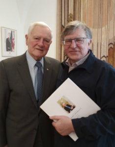 President Valdas Adamkus with journalist Vitalius Zaikauskas.