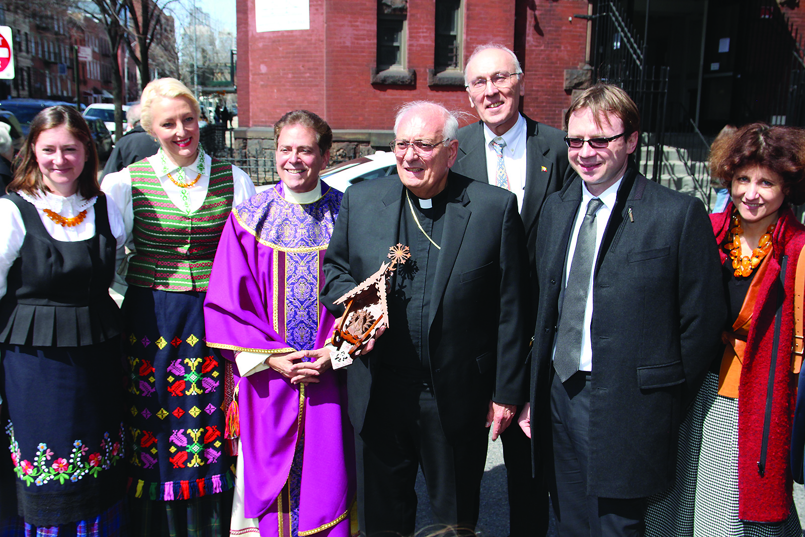 Lithuanians present a gift (Chapel of the Gates of Dawn) to Bishop Nicholas DiMarzio of Brooklyn. From left to right: Gitana Skripkaitė, Acting Chairman of the Consulate General of the Republic of Lithuania in New York; Rasa Sprindys, Chairman of the Lithuanian Community of New York; Msgr. Jamie Gigantiello, Pastor of Annunciation parish; Bishop Nicholas DiMarzio of Brooklyn; Raimundas Šližys;, Rolandas Kriščiūnas, the Ambassador of the Republic of Lithuania to the US; and Ambassador Audra Plepytė, Permanent Representative of Lithuania to the UN.