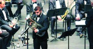 """Šiuo metu Algirdas Matonis yra pagrindinis eufonininkas """"River City Brass Band"""" orkestre."""