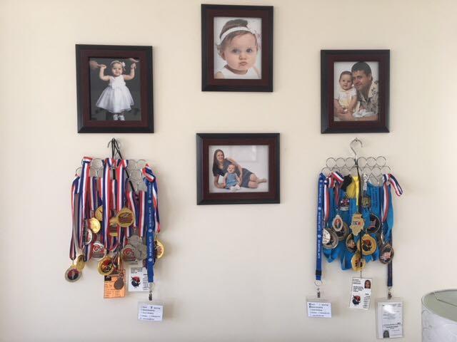 Karolinos iškovoti medaliai.