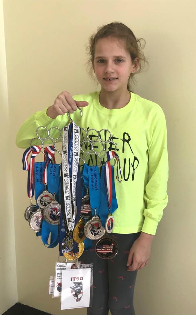 Karolina su dalim taekwondo varžybose iškovotų medalių.