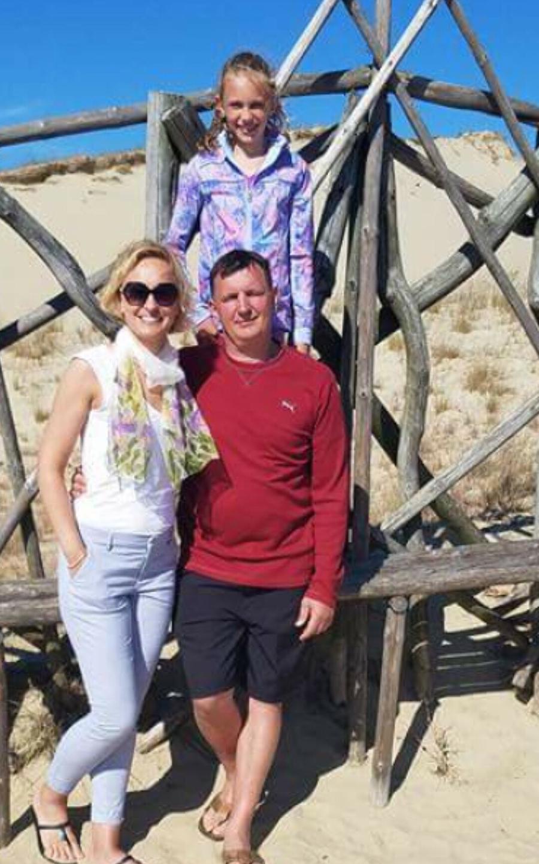Urtė su tėveliais Jurgita ir Rolandu.