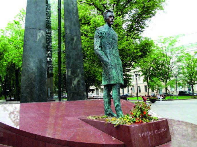"A thoughtful Vincas Kudirka looks out onto the streets of Vilnius, reminding passers by ""Vardan tos, Lietuvos, vienybė težydi."""