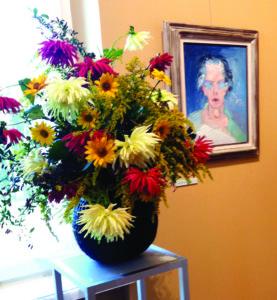 Gėlės prie Antano Lipskio autoportreto.