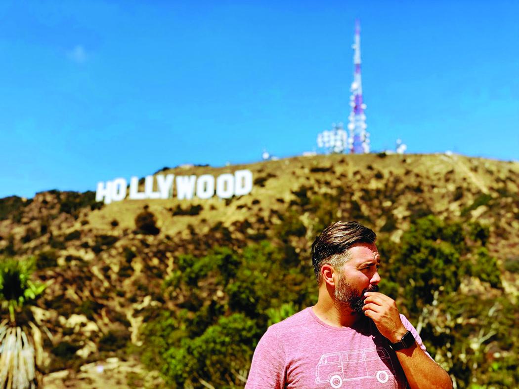 "Prie ""Hollywood"" ženklo Los Angele."
